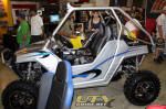 Long Travel Polaris RZR with aftermarket Roll Cage